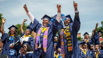WASHINGTON, DC - MAY 12: Britney Wilson, (seated front) of Brooklyn, New York, Tony Johnson, (front center, arms outstretched) and Blair C. Matthews, (right foreground) celebrate their graduation from Howard University in Washington, D.C., on Saturday, May 12, 2012. Wilson who has battled cerebral palsy all her life plans to attend law school. (Photo by Nikki Kahn/The Washington Post via Getty Images)