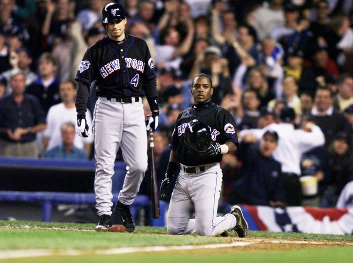 Timo Perez (right) after getting thrown out at the plate in Game 1.