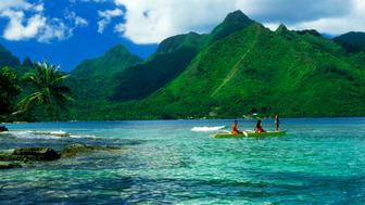 Polynesians at Opunohu Bay outrigger Moorea Island