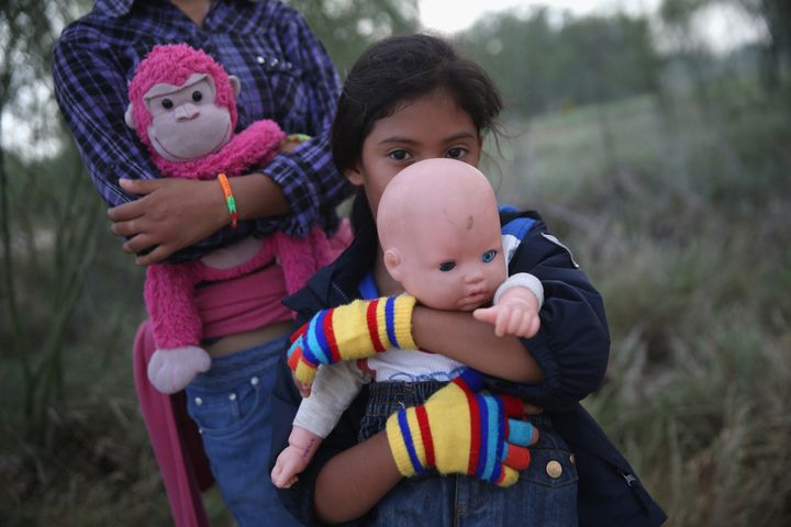 Salvadorian immigrant Stefany Marjorie, 8, holds her doll Rodrigo after crossing the Rio Grande from Mexico into the United S