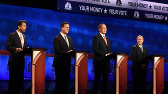 (L-R) Republican Presidential hopeful Bobby Jindal speaks as Rick Santorum, George Pataki, and Lindsey Graham look on during the first CNBC Republican Presidential Debate on  October 28, 2015 at the Coors Event Center at the University of Colorado in Boulder, Colorado. AFP PHOTO / ROBYN BECK        (Photo credit should read ROBYN BECK/AFP/Getty Images)