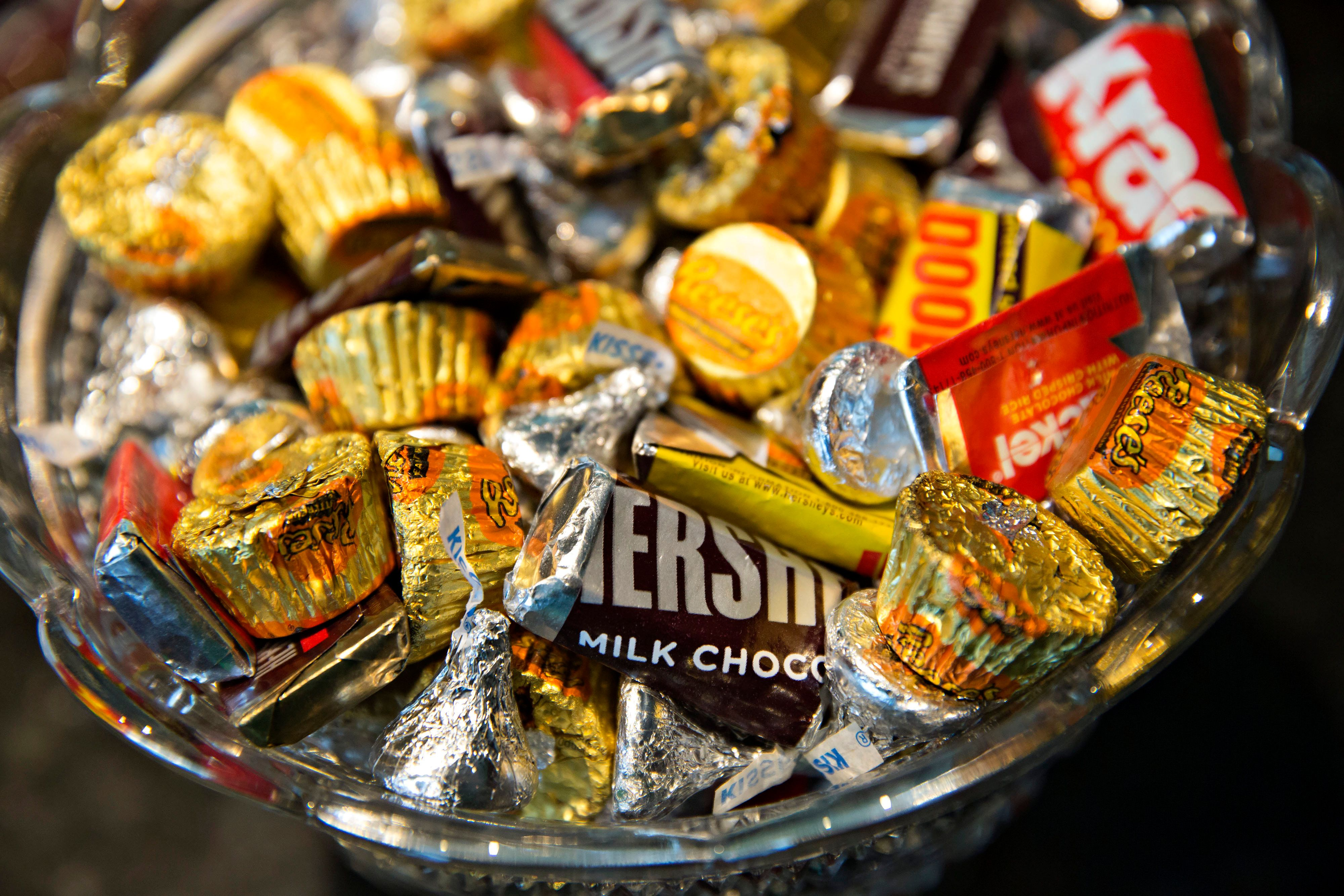 Various Hershey Co. chocolate candies are arranged for a photograph in a bowl in Tiskilwa, Illinois, U.S., on Tuesday, July 28, 2015. The Hershey Co. is scheduled to report second-quarter earnings on Friday, Aug. 7, 2015. Photographer:  Daniel Acker/Bloomberg via Getty Images