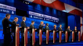 2016 presidential candidates John Kasich, governor of Ohio, from left, Mike Huckabee, former governor of Arkansas, Jeb Bush, former governor of Florida, Senator Marco Rubio, a Republican from Florida, Donald Trump, president and chief executive of Trump Organization Inc., Ben Carson, Carly Fiorina, former chairman and chief executive officer of Hewlett-Packard Co., Senator Ted Cruz, a Republican from Texas, Chris Christie, governor of New Jersey, and Senator Rand Paul, a Republican from Kentucky, participate in the Republican presidential debate at the University of Colorado in Boulder, Colorado, U.S., on Wednesday, Oct. 28, 2015. Three Republican senators running for president have come out swinging against a bipartisan budget deal as an emblem of everything that's wrong in Washington, making it a likely pinata in the party's third debate. Photographer: RJ Sangosti/Pool via Bloomberg