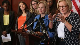 WASHINGTON, DC - JULY 30:  Sen. Claire McCaskill (D-MO) (R) and Sen. Kristen Gillibrand (D-NY) are joined by survivors of campus sexual assult during a news conference about new legislation aimed at curbing sexual assults on college and university campuses at the U.S. Capitol Visitors Center July 30, 2014 in Washington, DC. With strong bipartisan support in the Senate, the bill would require schools to make public the result of anonymous surveys about campus assaults and impose significant financial burdens on universities that fail to comply with some of the law's requirements.  (Photo by Chip Somodevilla/Getty Images)