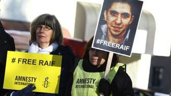 DAVOS, SWITZERLAND - JANUARY 24:  Amnesty International members hold a protest against the missing of 43 Mexican student and flogging punishment of Saudi blogger Raif Badawi, in Davos where the World Economic Forum is being held on January 24, 2015. (Photo by Evren Atalay/Anadolu Agency/Getty Images)
