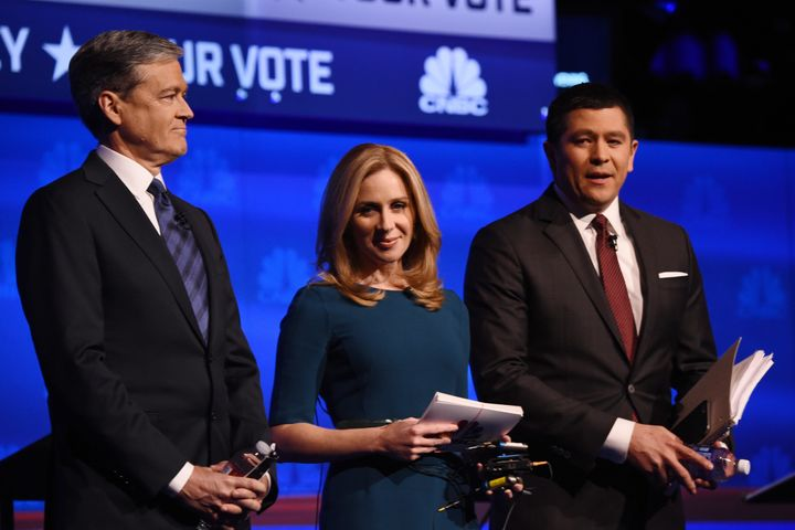 Moderators John Harwood, Beck Quick, and Carl Quintanilla on stage at the Republican debate.