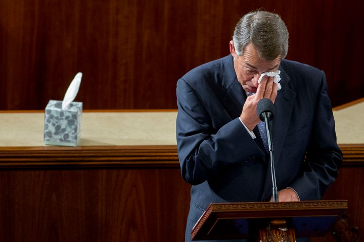 U.S. House Speaker John Boehner, a Republican from Ohio, wipes his eyes as he gives a farewell speech during a House Speaker