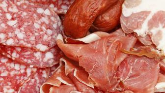 assorted sliced meat delicacies on plate close up