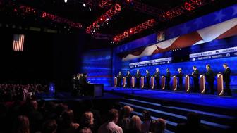 Debate moderators at left John Harwood, Becky Quick and Carl Quintanilla (L) question candidates at the third Republican Presidential Debate hosted by CNBC, October 28, 2015 at the Coors Event Center at the University of Colorado in Boulder, Colorado. Candidates (L-R) are Republican Presidential hopefuls (L-R) John Kasich, Mike Huckabee, Jeb Bush, Marco Rubio, Donald Trump, Ben Carson, Carly Fiorina, Ted Cruz, Chris Christie, and Rand Paul.  AFP PHOTO / ROBYN BECK        (Photo credit should read ROBYN BECK/AFP/Getty Images)