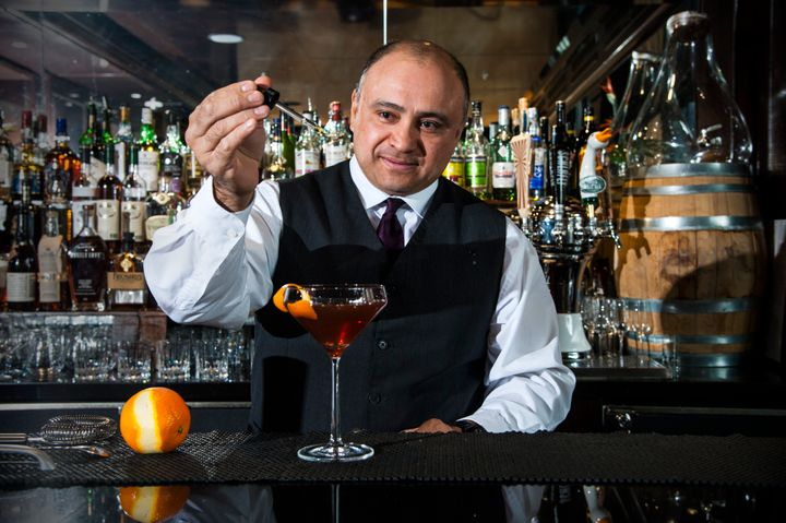 BartenderAngel Cervantes puts the finishing touches on the signature manhattan, made with barrel-aged local rye whiskey Byrrh, Dolin Vermouth and homemade bittersat Rye Bar at the Capella Hotel in Washington, DC.