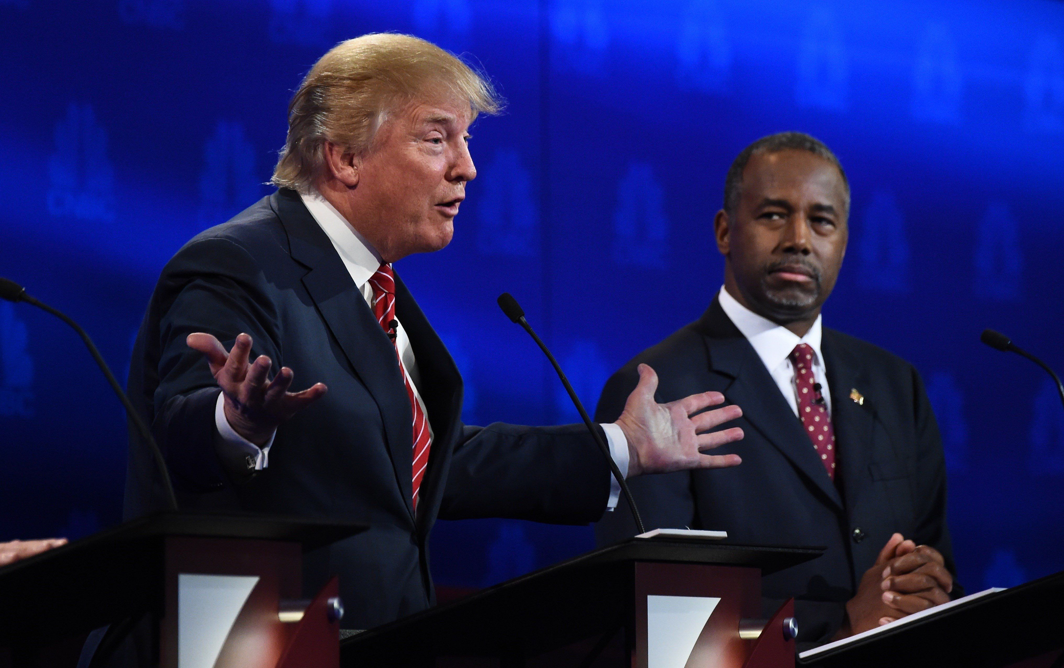 Republican presidential hopefuls Donald Trump and Ben Carson participate in the third Republican Presidential Debate, October 28, 2015 at the Coors Event Center at the University of Colorado in Boulder, Colorado.  AFP PHOTO / ROBYN BECK        (Photo credit should read ROBYN BECK/AFP/Getty Images)