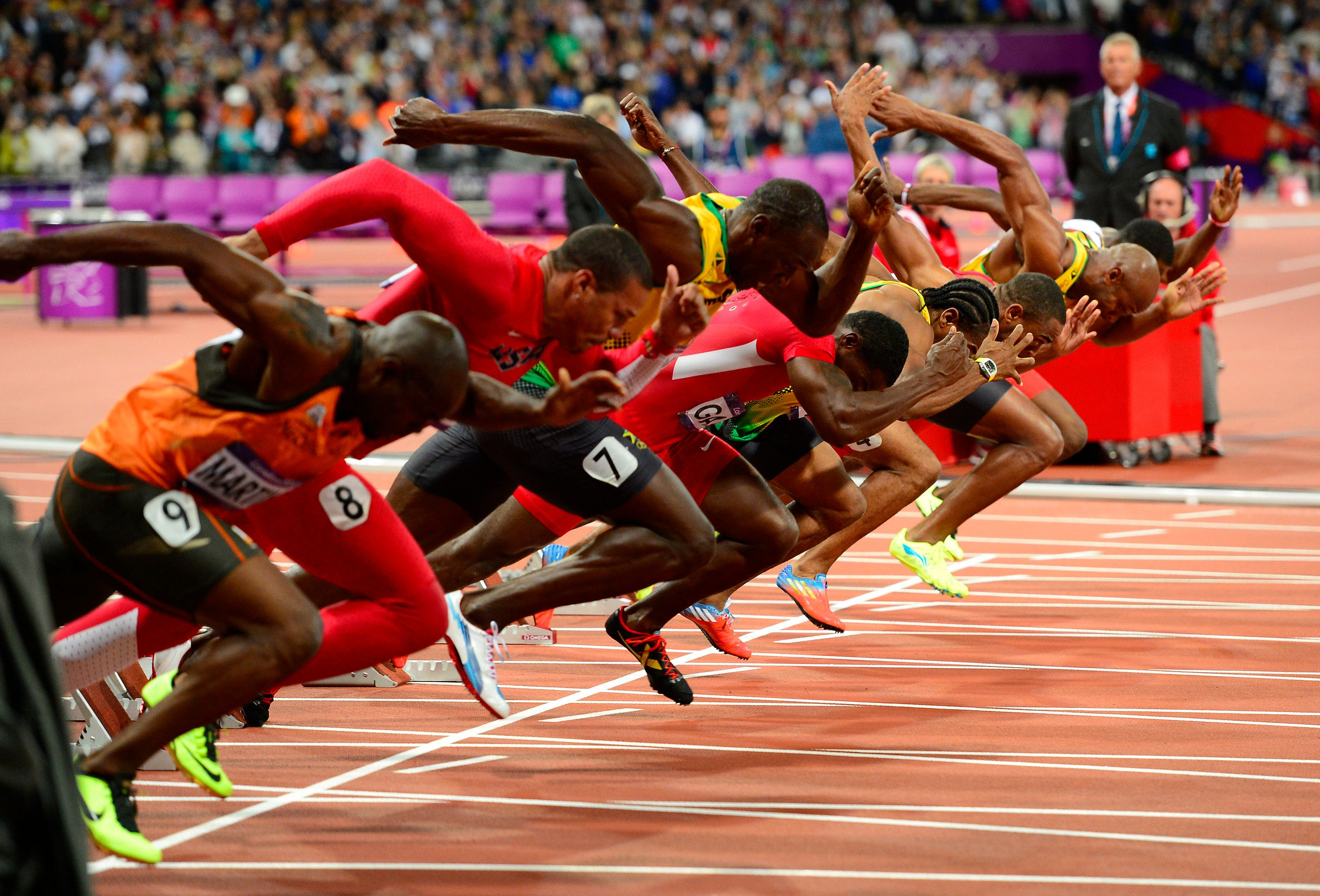 Usain Bolt of Jamaica, third from left, breaks from the start line for the men's 100m dash at Olympic Stadium during the 2012 Summer Olympic Games in London, England, Sunday, August 5, 2012. Bolt cruised to another Olympic victory in the event. (Harry E. Walker/MCT via Getty Images)