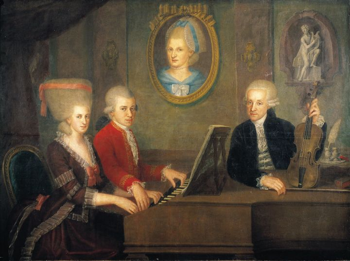 Leopold Mozart with his children Wolfgang and Nannerl at the piano, the portrait of their deceased mother on the wall. O