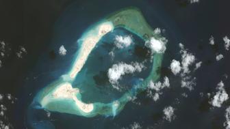 SUBI REEF, SOUTH CHINA SEA - MARCH 17, 2015:  DigitalGlobe imagery of the Subi Reef in the South China Sea, a part of the Spratly Islands group.  Image progression #2 of 3.  Photo DigitalGlobe via Getty Images.