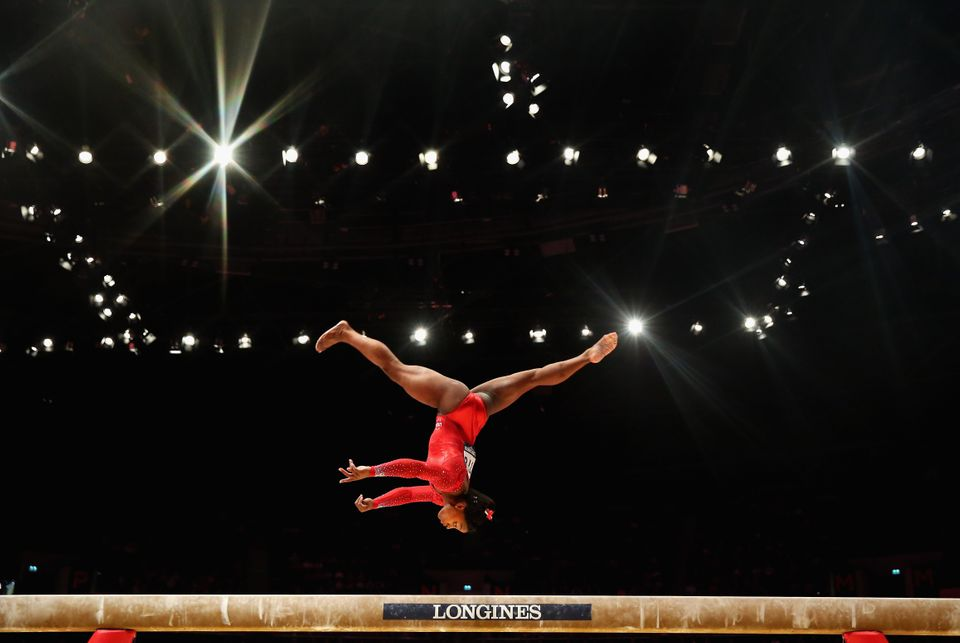 GLASGOW, SCOTLAND - OCTOBER 29:  Simone Biles of USA competes on the Beam during the All-Around Final on day seven of the 201
