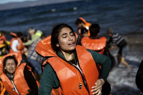 A woman arrives on Lesbos, Greece, on Oct. 28, 2015.