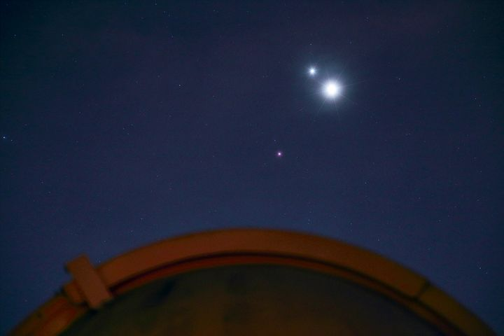 Jupiter and Venus shine close to each other, and Mars remains visible and apart from them.