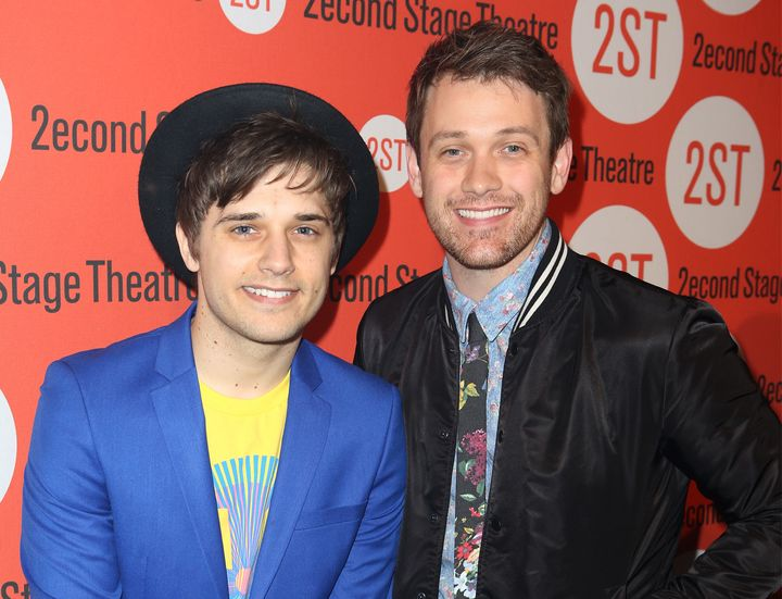 With fiancé Andy Mientus (left).