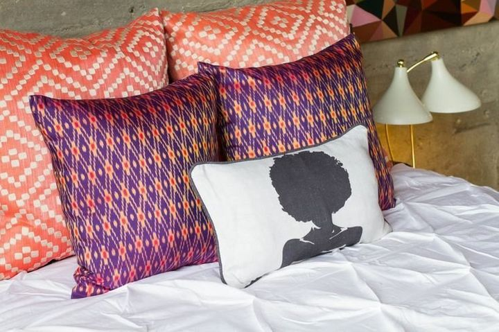 AphroChic founders Jeanine Hays and Bryan Mason prefer three layers of throw pillows on the bed to provide a comfortable yet eclectic mix.