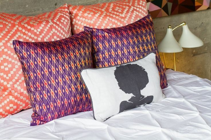 AphroChic founders Jeanine Hays and Bryan Masonprefer three layers of throw pillows on the bed to provide a comfortable