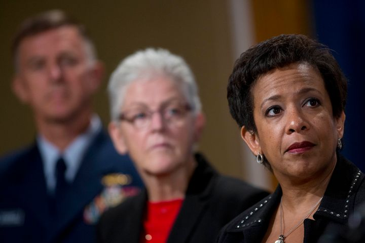 U.S. Attorney General Loretta Lynch, right, under pressure to investigate ExxonMobil for climate fraud.