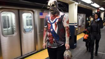 A zombie walks on the subway platform after the 41st annual Village Halloween Parade October 31, 2014 in New York. AFP PHOTO/Don Emmert        (Photo credit should read DON EMMERT/AFP/Getty Images)