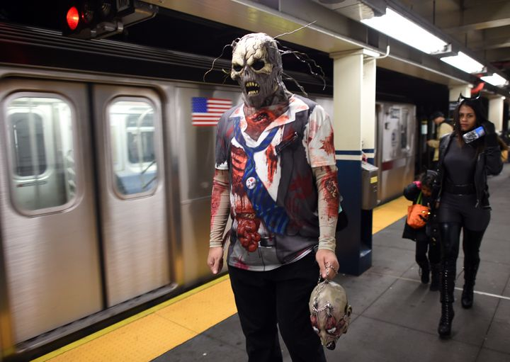 In New York City, zombies roam the subways on Halloween.