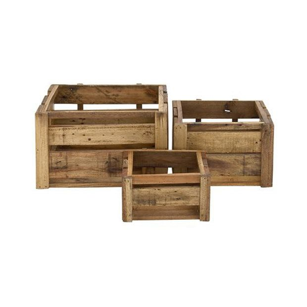 """<i><a href=""""http://www.dotandbo.com/collections/the-renovated-mill-house/28646-wood-panel-crates-set-of-3"""" target=""""_blank"""">Wood Panel Crates - Set of 3, $139</a></i>"""