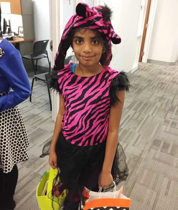 "Lisha, who was born in India, dressed as a pink zebra.&nbsp;<br><br>""I can finally be like my friends, because everybody's a"