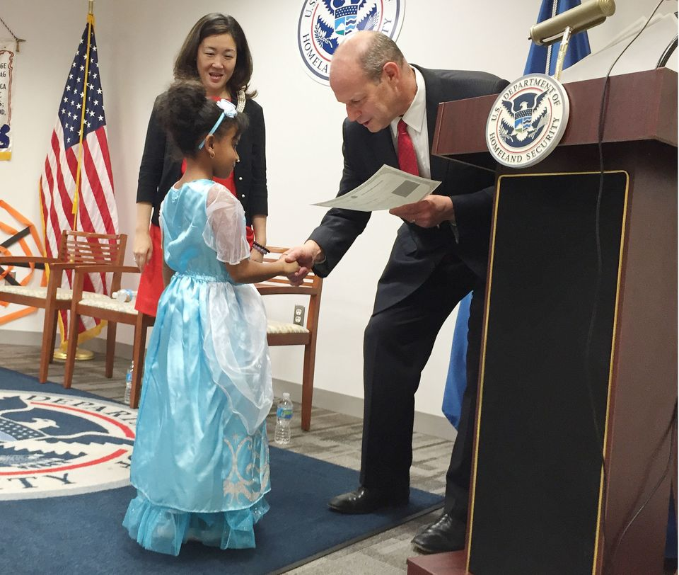 Yanet, from Ethiopia, dressed as Cinderella to get her citizenship certificate from USCIS Director León Rodr