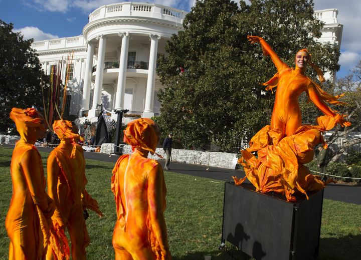 A woman dressed as fire performs on the South Lawn of the White House.