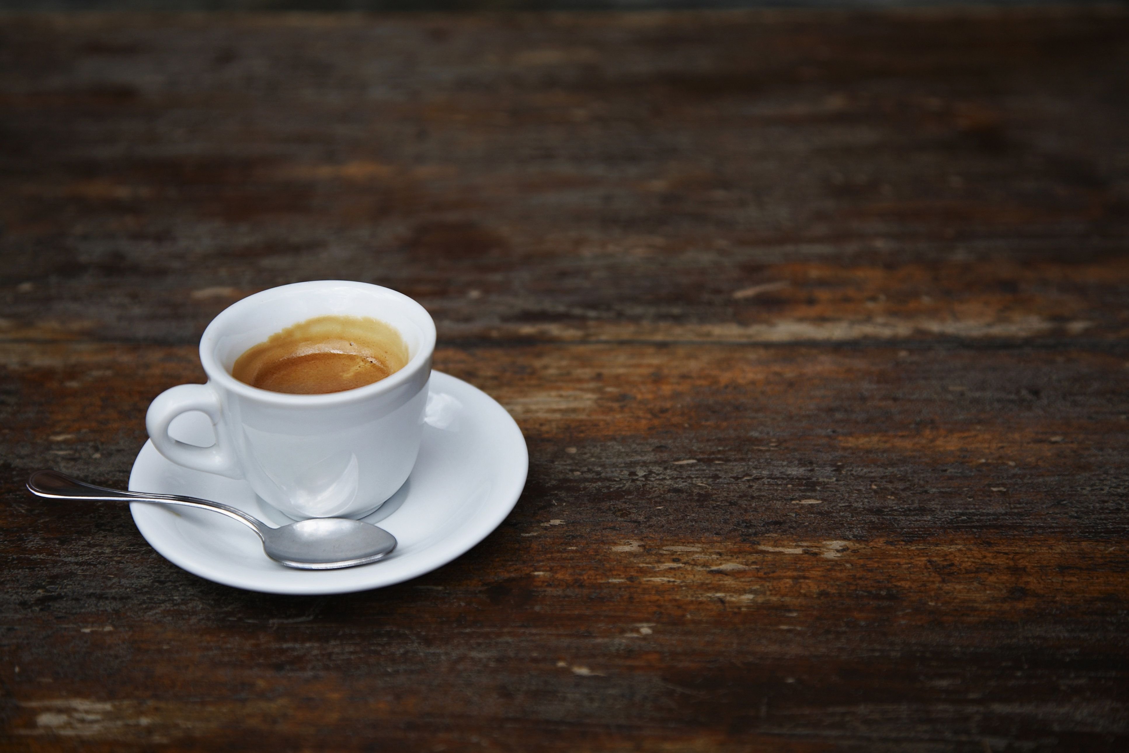 Espresso coffee on a rustic cafe' table
