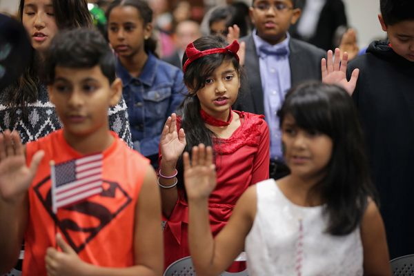 Mansur Rahimi, 12, and Muskan Rahimi, 9, take the Oath of Allegiance.