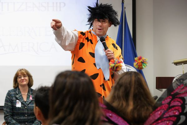 Rodriguez dressed as Fred Flintstone to talk to the kids.