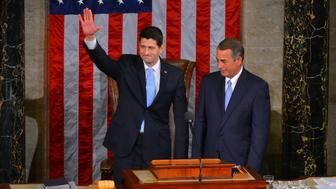 WASHINGTON, DC OCTOBER 29: Speaker-elect Paul D. Ryan, L, and outgoing Speaker John Boehner share the stage after Ryan is elected Speaker of the House in the House Chamber of the U.S. Capitol on Thursday, October, 29, 2015, in Washington, DC.   (Photo by Jahi Chikwendiu/The Washington Post via Getty Images)