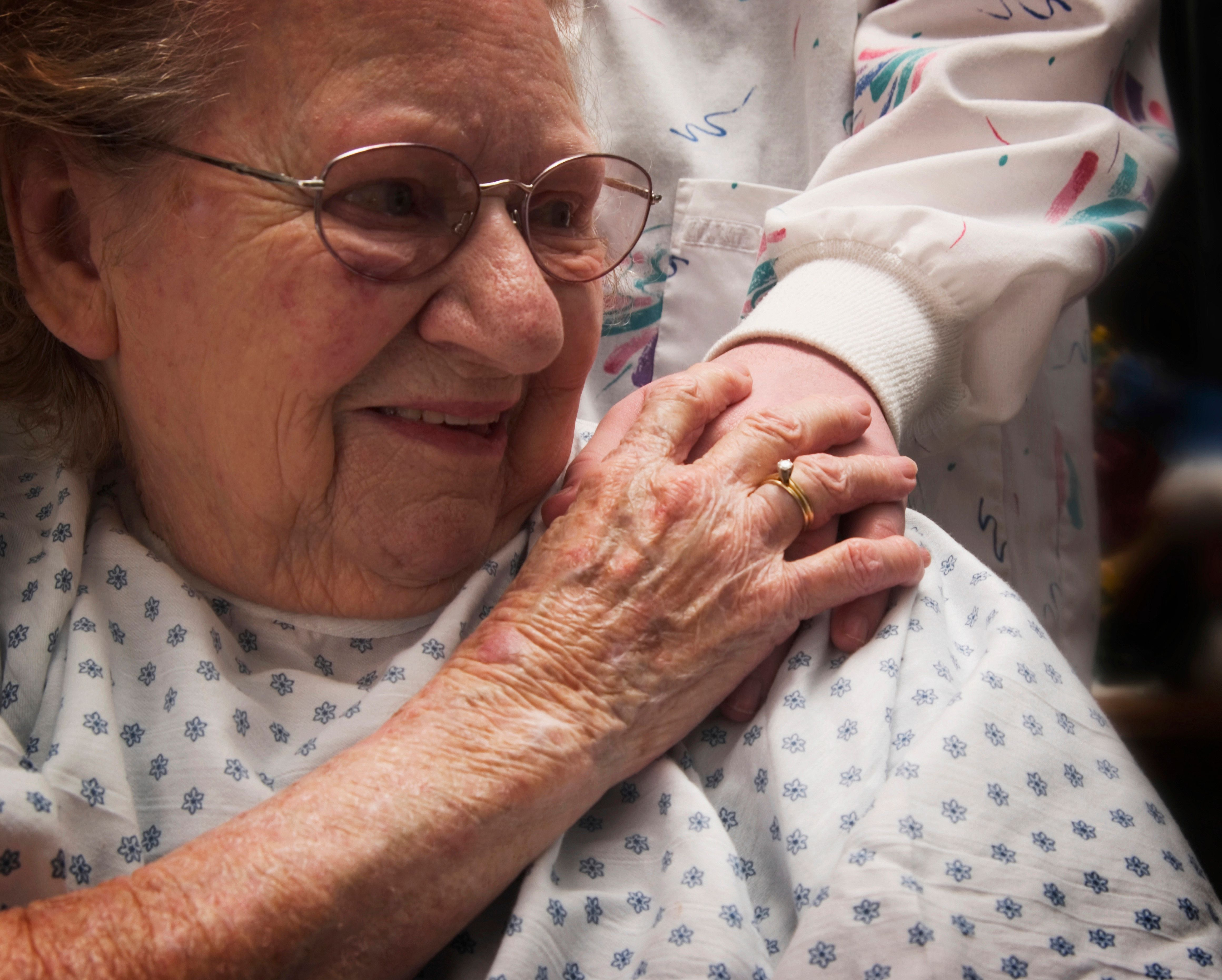 Nurse touching senior woman's shoulder