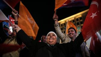 ANKARA, TURKEY - NOVEMBER 01:  Supporters of Turkey's Justice and Development (AK) Party gathering outside the AK Party's headquarters in Ankara, Turkey on November 01, 2015. The Justice and Development (AK) Party clinched victory after securing over 50 percent of votes in Turkeys 26th general election Sunday, according to preliminary results based on 81.37 percent of counted votes. (Photo by Ercin Top/Anadolu Agency/Getty Images)