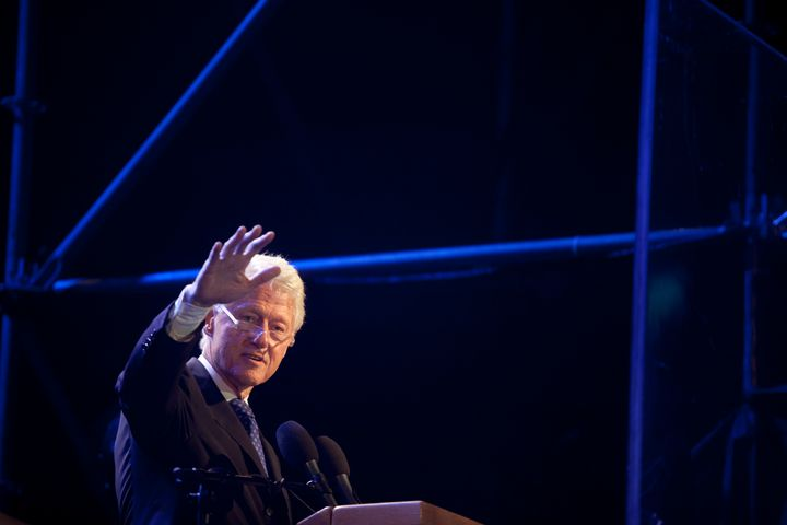 Former U.S. President Bill Clinton speaks during a rally on October 31, 2015, to commemorate the 20th anniversary of the assa