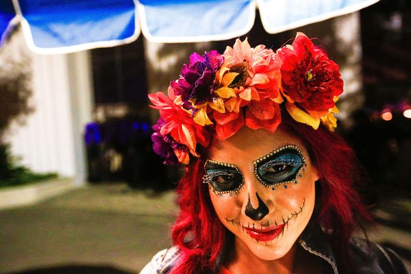 A guest with a painted on sugar skull attends the 2015 HARD Day of the Dead Festival at Fairplex on November 1, 2015 in Pomon
