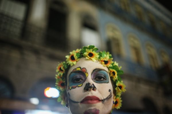 A reveler poses during a Day of the Dead party on November 1, 2015 in Rio de Janeiro, Brazil.