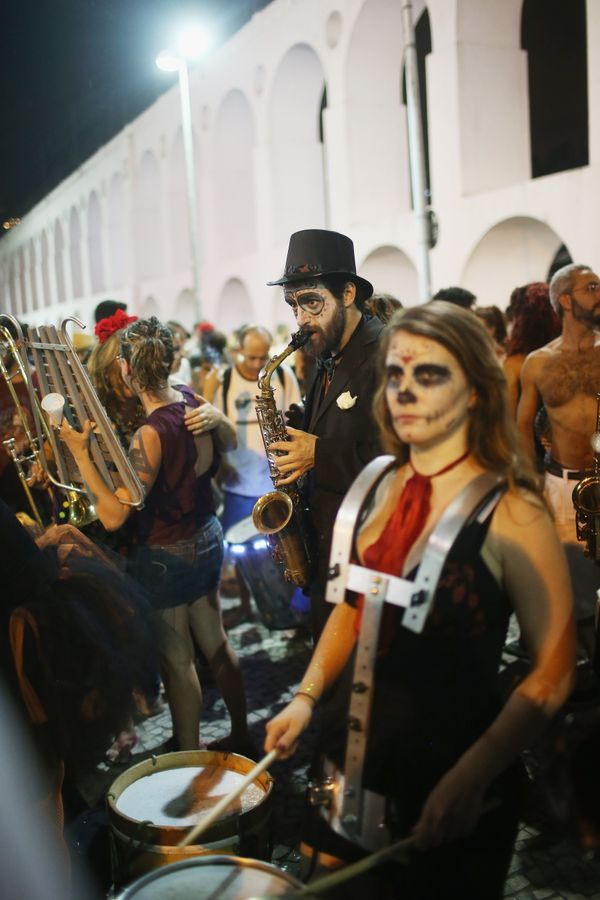 Revelers play music during a Day of the Dead party on November 1, 2015 in Rio de Janeiro, Brazil.
