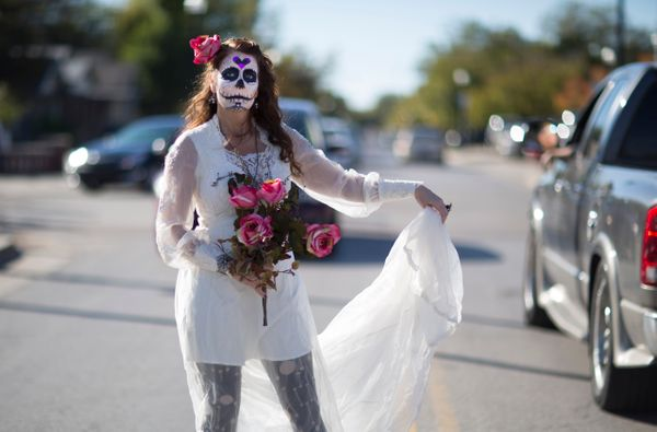 Teresa Phillips stops traffic during the Dia de los Muertos (Day of the Dead) celebration, November 1, 2015 in Oklahoma City,