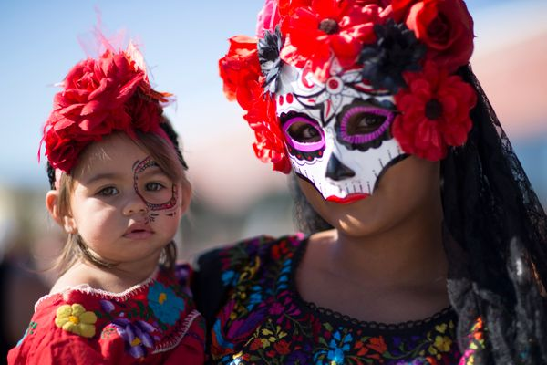 Victoria and Alessandra Reyes orginally of Zacateas, Mexico celebrate during the Dia de los Muertos (Day of the Dead) celebra