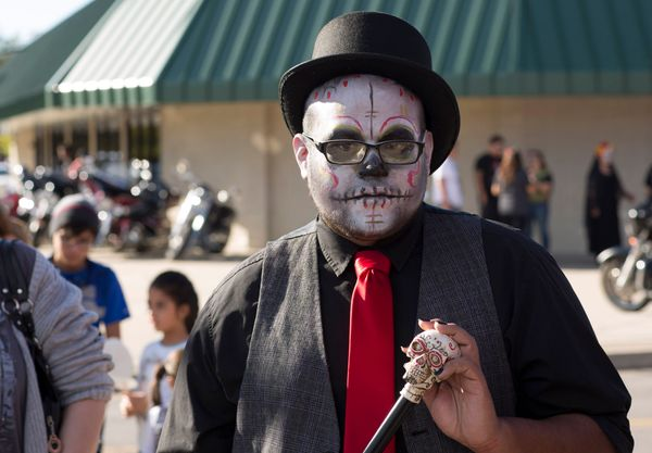 James Rodriguez poses for photos during the Dia de los Muertos (Day of the Dead) celebration, November 1, 2015 in Oklahoma Ci