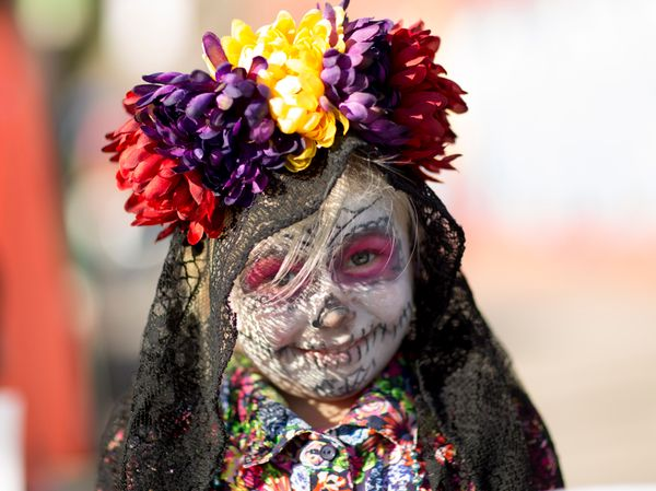 Taryn Johnson poses for photos during the Dia de los Muertos (Day of the Dead) celebration, November 1, 2015 in Oklahoma City