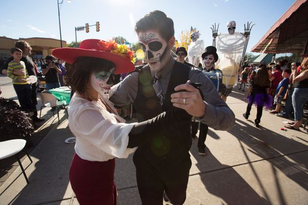 A couple dressed for the Dia de los Muertos (Day of the Dead) celebration dances in the street on November 1, 2015 in Oklahom