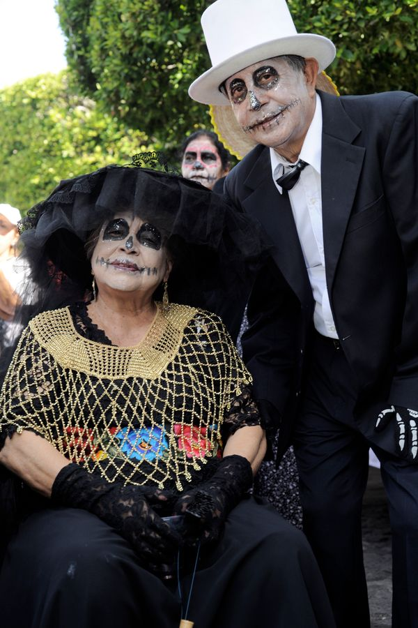 An old couple for pictures during the Catrinas contest as part of Day of the Dead celebration on October 31, 2015 in Morelia,