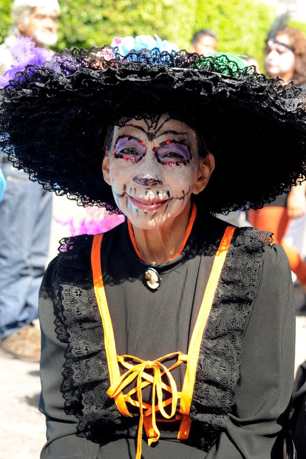A woman poses for pictures during the Catrinas contest as part of Day of the Dead celebration on October 31, 2015 in Morelia,