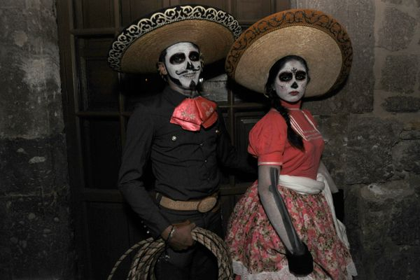 A young couple pose for pictures during the Catrinas contest as part of Day of the Dead celebration on October 31, 2015 in Mo