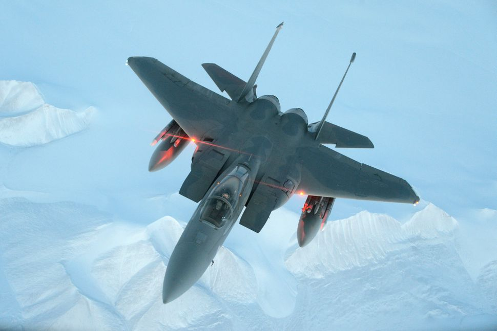 An F-15C Eagle from the 144th Fighter Wing flies above the High Arctic Oct. 22, 2015.